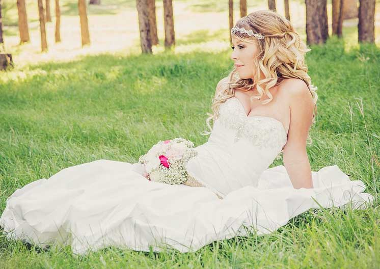 Bride sat on grass